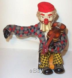 1950's BATTERY OPERATED HAPPY FIDDLER CLOWN MUSICAL TIN LITHO TOY very nice