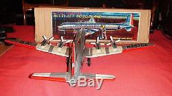 60's LARGE YONEZAWA TIN AMERICAN AIRLINES DC7C BATTERY OPERATED NEAR MINT WithBOX