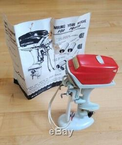 Vintage K&O 1957 Scott Atwater Toy Outboard Motor withStand and Sheet