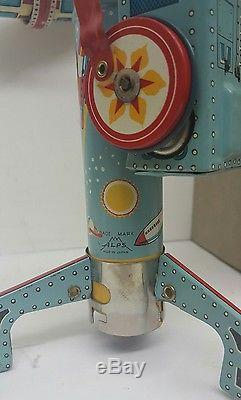 Vintage TWIRLY WHIRLY ROCKET RIDE Battery Op. Tin Lithograph Toy Twirley Whirley