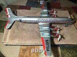 Vintage Tin Yonezawa Battery Operated American Airlines DC7 With Lighted Engines