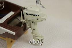 Vintage toy outboard boat